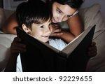 boy and girl reading light book ... | Shutterstock . vector #92229655