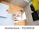 young   woman in kitchen... | Shutterstock . vector #92230018