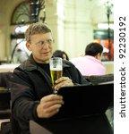 mature man reading menu card in ...   Shutterstock . vector #92230192