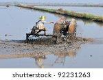 thai farmer on small tractor | Shutterstock . vector #92231263