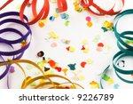 Confetti and streamers on white background with slight diffuse filter - stock photo