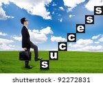 Businessman climbs the success stairway while brings a briefcase - stock photo