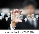 businessman holding lightbulb | Shutterstock . vector #92301439