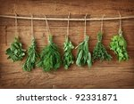 Fresh Herbs Hanging Over Woode...