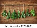Fresh Herbs Hanging Over Woode...
