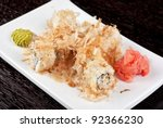 Sushi rolls of rice, nori, cream cheese, avocado, smoked salmon,cucumber and cuts of tuna - stock photo