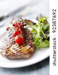 juicy grilled pork fillet steak with greens and cherry tomatoes - stock photo