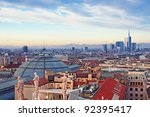 View of Milan from the rooftop of  Duomo di Milano. Statues of  Duomo of Milan, Galleria Vittorio Emanuele II and skycrapert of Porta Nouva also visible. - stock photo