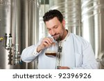 brewer standing in his brewery... | Shutterstock . vector #92396926