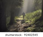 female hiker walking under the... | Shutterstock . vector #92402545