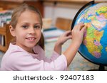 schoolgirl pointing at a... | Shutterstock . vector #92407183