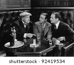 three men sitting together at a ... | Shutterstock . vector #92419534