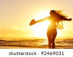 Carefree Woman Dancing In The...