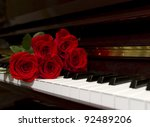 Red Rose Bouquet On The Piano...