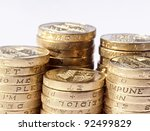 Stack Of Uk Coins On White...