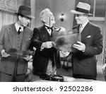 three men looking at x rays | Shutterstock . vector #92502286