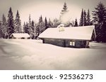 Remote Log Cabin In Winter Wit...