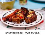 Grilled chicken and sausage - stock photo