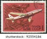 USSR - CIRCA 1969: A stamp printed by USSR shows  turbojet-powered Soviet airliner TU-104, series, circa 1969 - stock photo