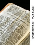 Small photo of Bible Series. close up detail of antique holy bible open to the gospel according to the epistle of paul the apostle to the galatians in the new testament