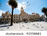 pigeons flying over city hall... | Shutterstock . vector #92558881