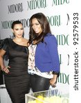 WEST HOLLYWOOD, CA - MAY 10: LaLa Vasquez, Kim Kardashian at the Midori Melon Liqueur Trunk Show at Trousdale on May 10, 2011 in West Hollywood, California - stock photo