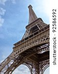 Eiffel Tower. The symbol of Paris and France against the backdrop of clear blue sky. vertical orientation - stock photo