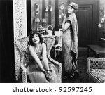 woman sitting in an armchair...   Shutterstock . vector #92597245