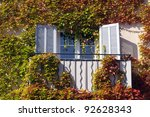 window surrounded by vegetation, leaves - stock photo