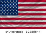 complete national flag of us covers whole frame, waved, crunched and very natural looking. It is perfect for background - stock photo