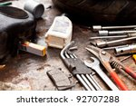 Different tools in a dirty workshop - stock photo