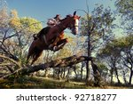 Stock photo image of beautiful girl with purebred horse jumping a hurdle in forest 92718277