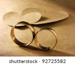 Gold Wedding Rings And Paper...