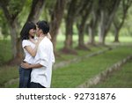 Asian Young Couple Hugging In...