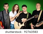 Musical group of artists on a green background - stock photo