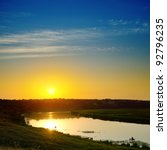 good sunset over river - stock photo