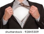 Businessman in classic superman pose tearing his shirt open to reveal blank copy space on chest - stock photo