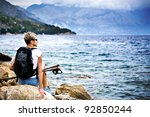 a woman hiking at the sea | Shutterstock . vector #92850244