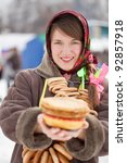 Smiling girl with pancake  during  Shrovetide at Russia - stock photo
