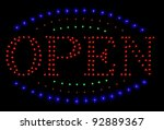 Neon Sign Open Against A Black...