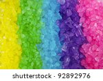A Close Up Of A Rainbow Of...