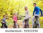 family on bikes in the park | Shutterstock . vector #92921950