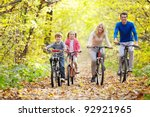 family on bikes in the park in... | Shutterstock . vector #92921965
