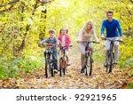 family on bikes in the park in... | Shutterstock . vector #92921965