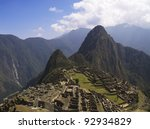 Machu Picchu, Wayna Picchu and surrounding mountains in the background. - stock photo