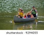 Family in a Canoe on a Lake - stock photo