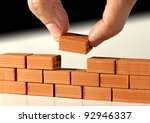 two fingers put the last brick... | Shutterstock . vector #92946337