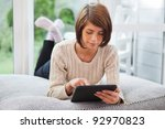 pretty young woman using tablet ... | Shutterstock . vector #92970823