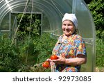 Mature Woman With Ripe Tomatoe...