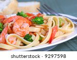 Fettuccine Pasta with Shrimp Dinner Dish and Vegetables - stock photo